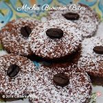 Six round Mocha Brownie Bites, 5 shape a circle and one rests on top