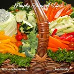 Simply Spinach Dip to the left in a brown wicker basket filled with raw veggies