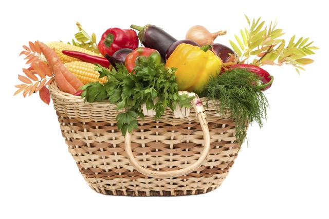 lots of fresh and ripe vegetables in the basket on white background