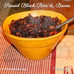 Seared Black Rice & Beans in a yellow bowl on a red and white checked cloth