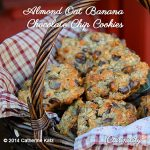 Almond Oat Banana Chocolate Chip Cookies on a red flannel napkin in a brown wicker basket