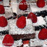 Chocolate Brownies with confectioners sugar and fresh raspberries on top
