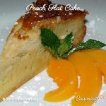 Thin slice of Peach Flat Cake with fresh peach slices on the side