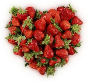 red strawberries in heart shape