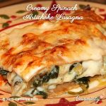 Slice of Creamy Spinach Artichoke Lasagna on a round plate with decorative holly and red stars