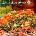 Tuscan Bean Spinach Pasta with spinach, tomatoes and olive oil drizzle on whole wheat pasta