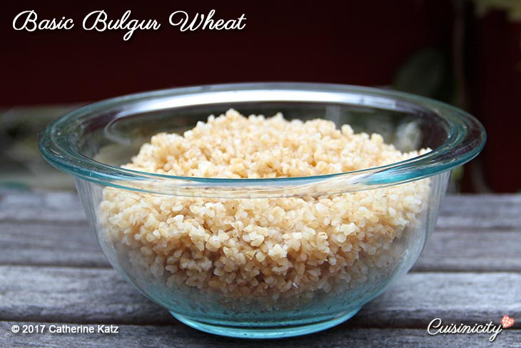 Basic Bulgur Wheat in a glass bowl sitting on a gray wood table
