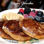 vegan pancakes with fresh fruit on plate